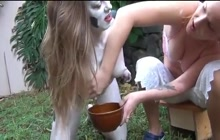 Brunette gets boobs milked outdoor