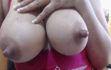 Big boobed slut squeezes her nipples for milk