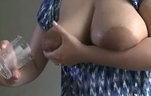 Huge boobed MILF squirting milk from her tits