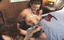 Submissive girl tied and milked